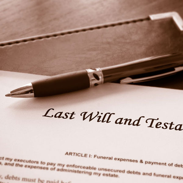 pen laying on Last Will and Testament page